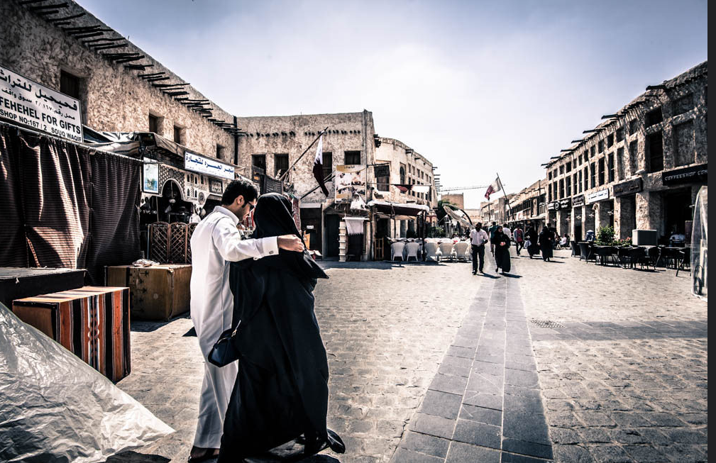 A Couple Walks in a Doha Souq
